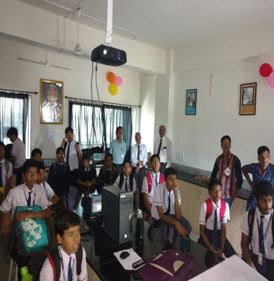 Science Association program inauguration by Principal Dr. S. N. Nikam and activity with High school students.